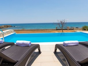 3 Bebrooms, newly built, seafront villa with private pool next to taverns